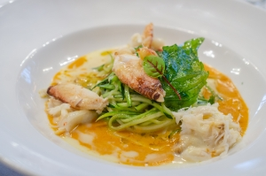 LOCAL DUNGENESS CRAB lobster bisque emulsion, zuchini spaghettini, crispy basil leaves