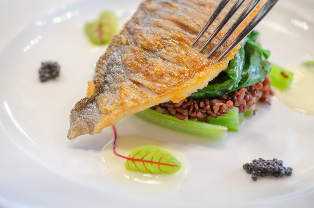 SEARED MEDITERRANEAN SEABREAM WITH NORTHERN DIVINE WHITE STURGEON CAVIAR sautéed golden swiss chard, camargue red rice